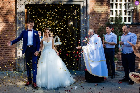 Wedding photo from St. Sofia Church of the bride and groom leaving under a storm of Confetti