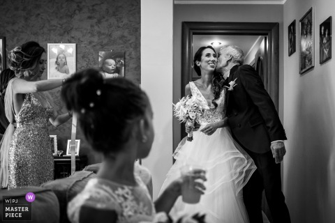 Italian Bride is just ready and her father sees her for the first time with wedding dress