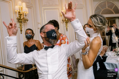 The masked bride and groom are enjoying the party at Ritz Paris