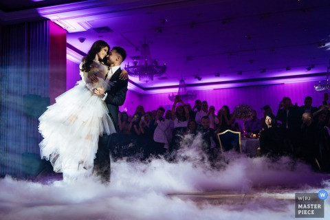 Wedding photography from Sofia, Bulgaria of the First dance with fog and purple lights