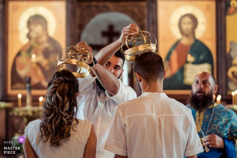 Wedding photography in Tsarevo, Bulgaria during an Orthodox ceremony of the crowns