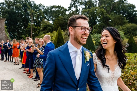 Outdoor wedding photography from Buitenplaats Amerongen created Right after the ceremony, exit of happy bride and groom
