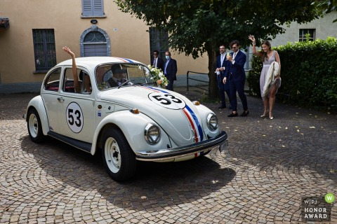 IT wedding photography from Church of SS Ippolito e Cassiano, Luvinate of Herbie the love bug vw car