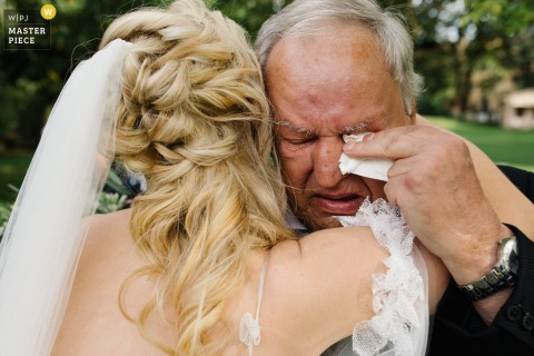 Bride with her grandfather in tears at Borgo San Luigi, Tuscany