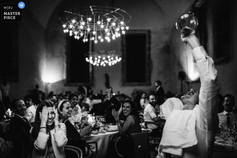 Wedding photo from a party reception in terras de bouro - amares - portugal of a guest drinking from a bottle