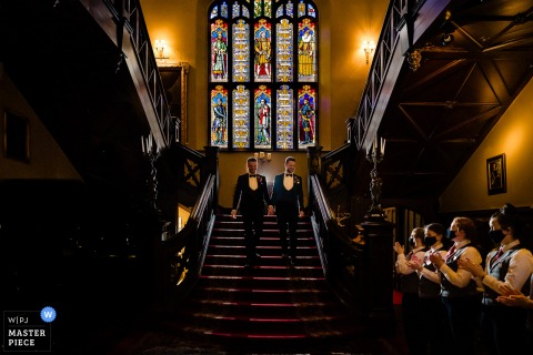 Markree Castle wedding image of grooms walking down stairs to the ceremony