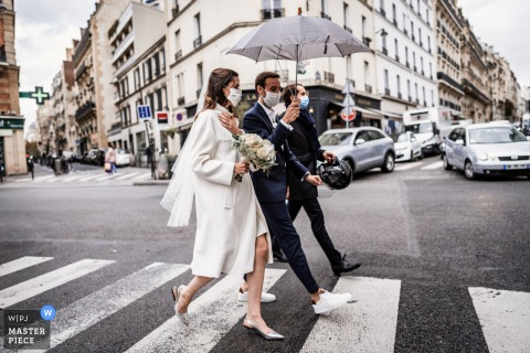 Bride and Groom are walking to the City Hall in Paris, France