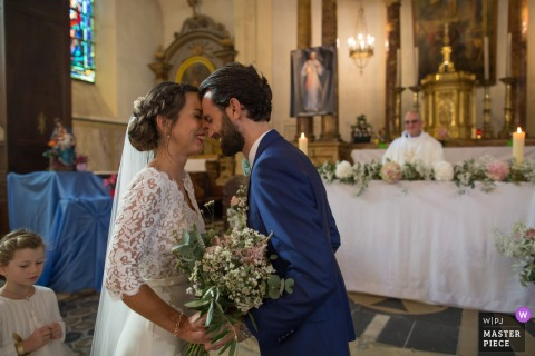 Wedding photography from a Church in France, Pons of the Bride and groom just discovering each other