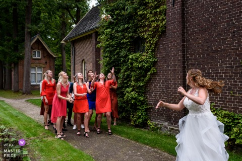 Wedding photography from a Netherlands Reception Venue of the Bride tossing her bouquet