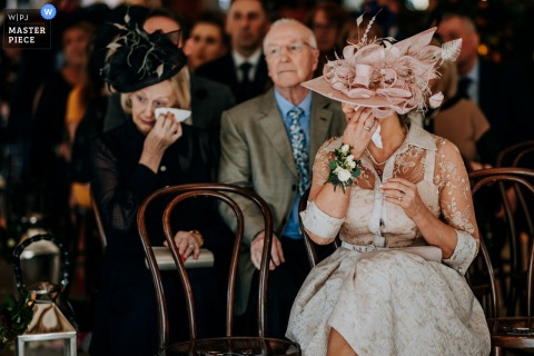 Mum and grandmother both cry together just before the bride enters the ceremony room at this UK wedding