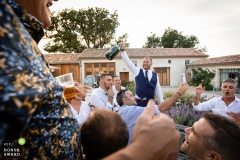 Gers wedding photo from a Private place at Saint-Leonard, France showing the Groom with his best friends outside having a party