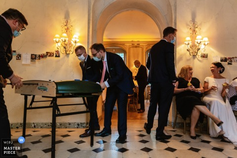 Image from a Île-de-France wedding Reception venue of Guests playing baby foot at wedding reception
