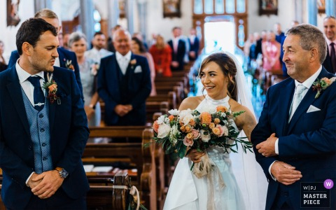 Groom gives great reaction to Bride at top of aisle at a church in County Meath, Ireland