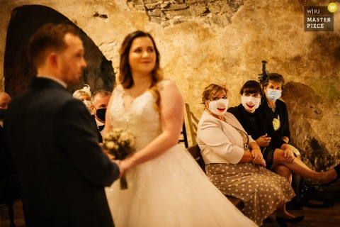 Wedding image of Neidpath Castle, Peebles, Scotland Guests during the ceremony wearing their COVID masks