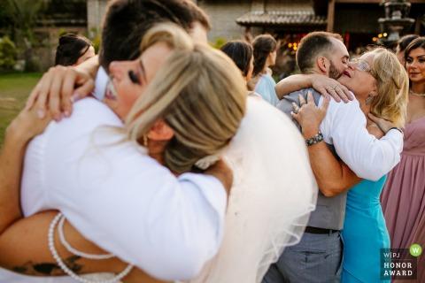 Brazil wedding photography from Sítio da Figueira, Porto Alegre of the Grooms hugging groomsmen
