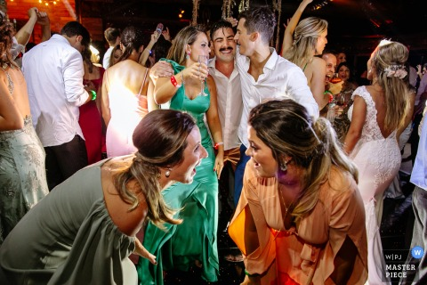 Wedding photography from Emma Trein - Canela - Brazil of the Guests dancing with groom behind