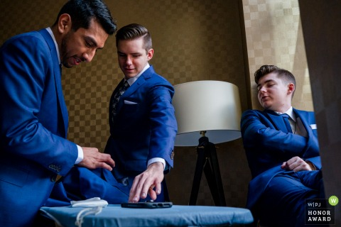 Wedding image from Belvedere, Baltimore MD of The groomsmen ironing their wedding attire