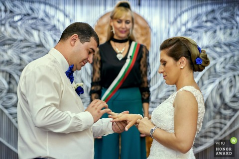 Sofia wedding photography from Bulgaria during an indoor ring Wedding ceremony