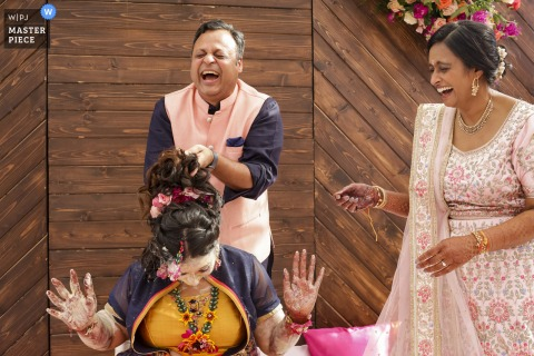 Backyard Indian wedding of the bride's father and mother in full laughter