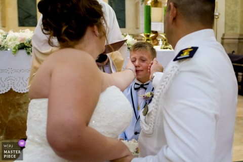 Spain Wedding ceremony of the bride wiping the tears of her son as he became very emotional