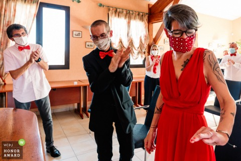 French civil wedding photography from Oradour-sur-glane, France showing Love, ring, and mask