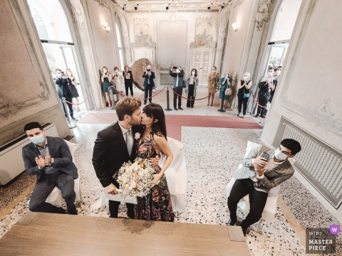 Villa Litta Modigliani wedding ceremony image of the groom kissing the bride