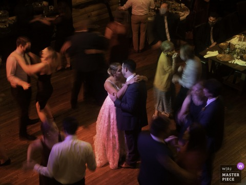 Virginia wedding photography from Lydia Mountain Lodge/Stanardsville VA showing Dancing with a slow shutter motion blur