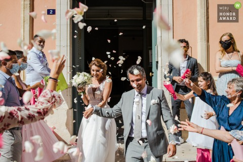 Outdoor celebration wedding photography from the ceremony showing the Exit of the town hall of Siant-Tropez