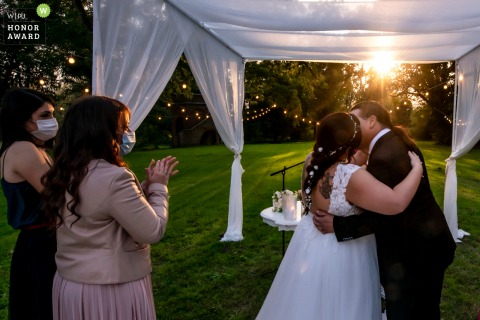Italy outdoor, garden wedding photography from a Ceremony at Villa Angeli, Pegognaga, Mantua With an applause and a kiss from the couple, I try to recreate the intense moment that was breathed under a beautiful sunset