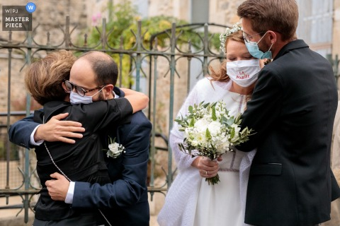 Mairie de Nîmes wedding photo of family giving hugs to one another after the marriage in South France