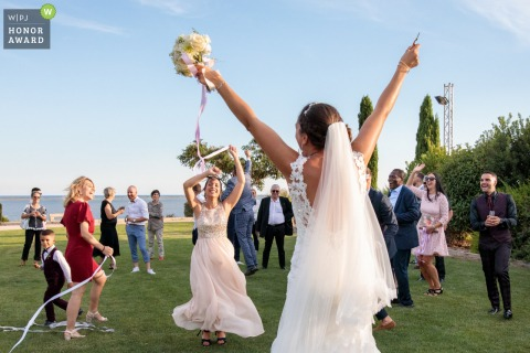 French outdoor wedding photography from Domaine des Moures, Montpellier south of Francecreated as The bride has just cut the last ribbon that connects her bouquet