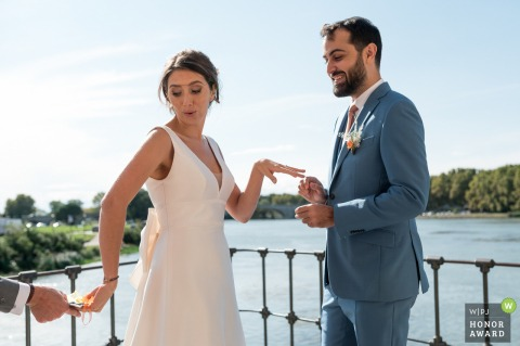 Outdoor ceremony wedding photography overlooking the water at The bridge of AvignonBefore the ring exchange and vows