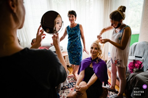 Wedding photographer captured this moment from Montana, Bulgaria of the Bride getting ready