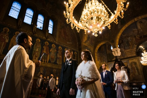 Bulgaria ceremony wedding photography from St. Nedelya Church, Sofia of the bride and groom in low light