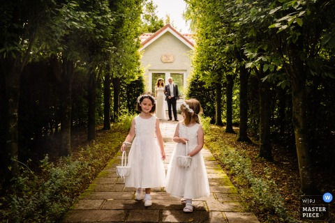 A Dublin wedding photographer captured this Cork, Ireland Arrival of the flower girls