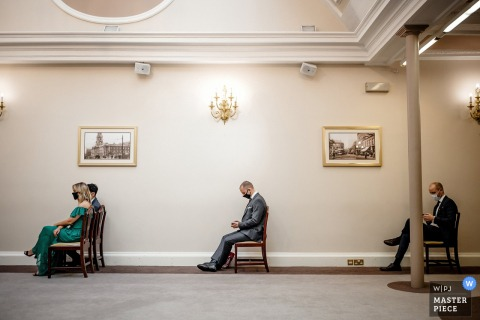 UK wedding photography from the stockport town hall	showing wedding guests in covid-19 face masks
