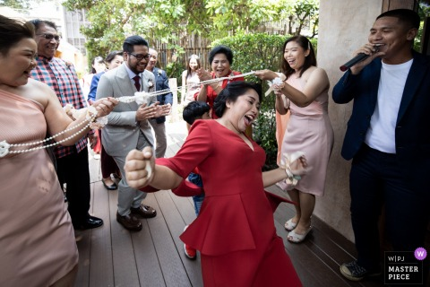 London wedding reportage photographer captured this moment at the England	U Hotel, Pattaya during a wedding game