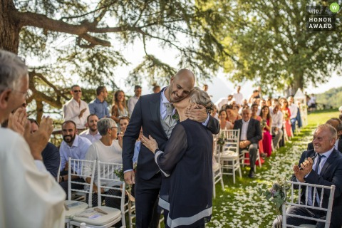 Italy outdoor wedding photography from a Rossino castle garden ceremony of the mother's hug before the ceremony