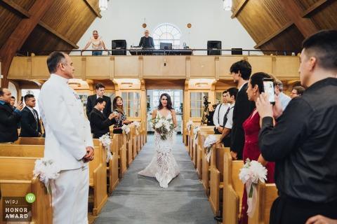 Virginia indoor ceremony wedding photo of the Bride walking in the church