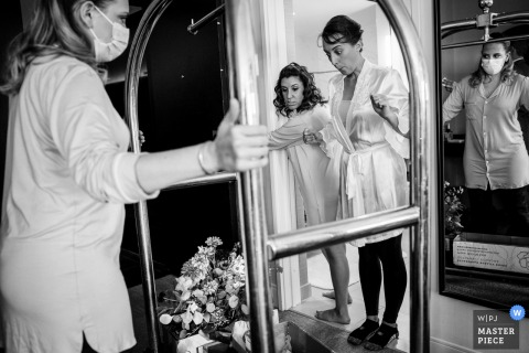 Pennsylvania wedding photography of the Bride seeing her flowers for the first time on the day as her bridesmaids roll them into the hotel room