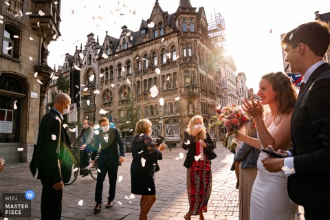 Vlaams Brabant wedding photography of the couple outdoors at the Town Hall Gent	with a A little magic in 2020 with COVID masks on