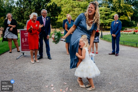 A Utrecht wedding photographer captured this humor image from this Netherlands ceremony location of a kid crying with bouquet