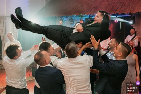 Malopolskie wedding Reception Venue flying groom wedding image from Krakow
