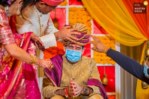 Michigan wedding photographer created this image at the Mariott Eaglecrest Golf Course & Resort, Ypsilanti, MI of the Puja ceremony for groom