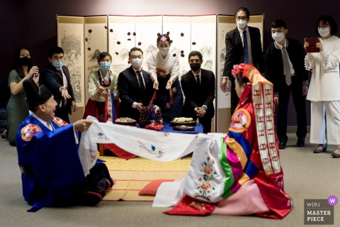 Wedding ceremony image from Living Vine Fellowship Church in Washington as the Family throws chestnuts during Pyebaek ceremony