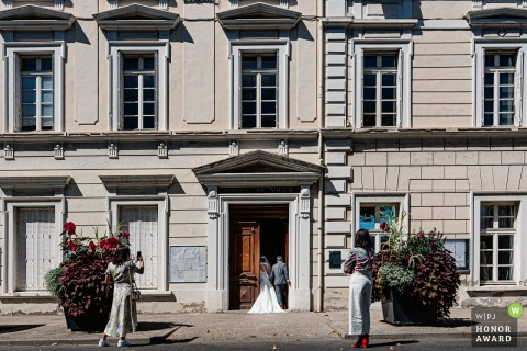 Romans-sur-Isère wedding image of the bride and groom entering the town hall in France
