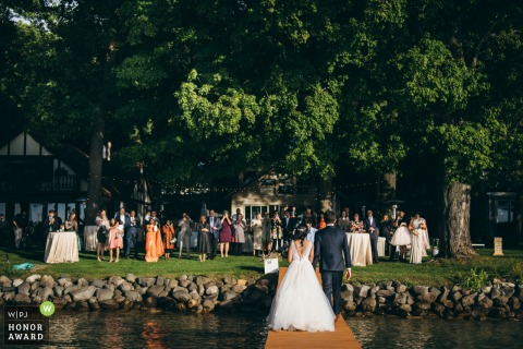 Chicago Bride & Groom Arriving At Reception on a dock