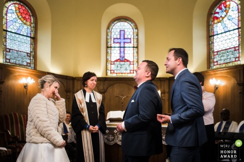 Indoor wedding photography from Bas-Rhin At the church during the ceremony from the moment to give the rings, the groom's witness just told a secret joke