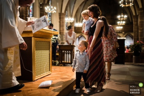 Church wedding photography from Bas-Rhin as the Boy with the rings came at the altar to give the rings to the vicar, but he throws it on the floor, creating a huge laugh in the assembly