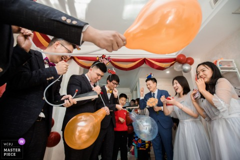 Nanjing, China wedding photography of door games with balloons popping